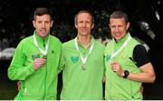 17 April 2016; Second place finishers in the Master Men's relay race, from left, Ronan Kearns, Paul Fleming and Barry Minnock, Rathfarnham W.S.A.F. AC, Dublin. The GloHealth AAI National Road Relays. Raheny, Dublin. Picture credit : Tomás Greally /  SPORTSFILE