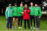 17 April 2016; Paddy Noonan, left, and  Patrick Boland, centre, with the winners of the Senior Men's relay race, from left, Mick Clohisey, Kieran Kelly, Mark Kirwan and Daire Bermingham, Raheny Shamrock AC, Dublin. The GloHealth AAI National Road Relays. Raheny, Dublin. Picture credit : Tomás Greally /  SPORTSFILE