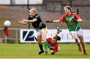 23 April 2016; Laura Rogers, Kerry, is tackled by Sarah Tierney, supported by Nicola O'Malley, Mayo. Lidl Ladies Football National League, Division 1, semi-final, Mayo v Kerry. St Brendan's Park, Birr, Co. Offaly. Picture credit: Ramsey Cardy / SPORTSFILE