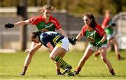 23 April 2016; Patrice Dennehy, Kerry, is tackled by Clodagh McManamon, left, and Doireann Hughes, Mayo. Lidl Ladies Football National League, Division 1, semi-final, Mayo v Kerry. St Brendan's Park, Birr, Co. Offaly. Picture credit: Ramsey Cardy / SPORTSFILE