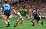 21 August 1994; Leitrim's Colin McGlynn in action against Dublin's Ciaran Walsh and Paddy Moran. Bank of Ireland Football Championship Semi Final. Dublin v Leitrim. Croke Park. Dublin. Picture credit; Ray McManus / SPORTSFILE