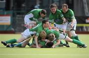 9 May 2010; Richard Shaw, Glenanne, is congratulated by his team-mates after scoring his side's third goal. Irish Senior Men's Cup Final, Monkstown v Glenanne, National Hockey Stadium, UCD, Belfield, Dublin. Picture credit: Brian Lawless / SPORTSFILE