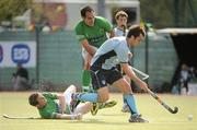 9 May 2010; Cian Speers, Monkstown, in action against Stephen Butler and Mick McGuinness, left, Glenanne. Irish Senior Men's Cup Final, Monkstown v Glenanne, National Hockey Stadium, UCD, Belfield, Dublin. Picture credit: Brian Lawless / SPORTSFILE
