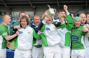 9 May 2010; Glenanne captain Joe Brennan lifts the cup with his team-mates. Irish Senior Men's Cup Final, Monkstown v Glenanne, National Hockey Stadium, UCD, Belfield, Dublin. Picture credit: Brian Lawless / SPORTSFILE