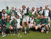 9 May 2010; Glenanne captain Joe Brennan celebrates with his team-mates. Irish Senior Men's Cup Final, Monkstown v Glenanne, National Hockey Stadium, UCD, Belfield, Dublin. Picture credit: Brian Lawless / SPORTSFILE