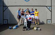 11 May 2010; Ten year old Oisin Madden, from Knocklyon, Dublin, who fell from his bicycle recently, lifts the Liam MacCarthy Cup as inter county hurlers, Stephen Hiney, Dublin, David Collins, Galway, Brian Hogan, Kilkenny, Conor O'Mahony, Tipperary, and Shane McNaughton, Antrim, look on at the launch of the 2010 GAA Hurling Championships. Ballyboden St. Enda's, Firhouse Road, Dublin. Picture credit: Brendan Moran / SPORTSFILE
