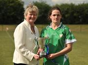 16 May 2010; Ann Dalton, Leinster, receives the the Provincial Cup from Joan Flynn. 2010 Gael Linn Senior Inter-Provincial Championship Camogie Final, Munster v Leinster, Trim GAA Club, Trim, Co. Meath. Picture credit: Barry Cregg / SPORTSFILE