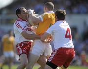 23 May 2010; Paddy Cunningham, Antrim, in action against Brian Dooher and Dermot Carlin, Tyrone. Ulster GAA Football Senior Championship Quarter-Final, Antrim v Tyrone, Casement Park, Belfast, Co. Antrim. Picture credit: Oliver McVeigh / SPORTSFILE