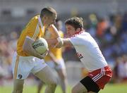 23 May 2010; Paddy Cunningham, Antrim, in action against Dermot Carlin, Tyrone. Ulster GAA Football Senior Championship Quarter-Final, Antrim v Tyrone, Casement Park, Belfast, Co. Antrim. Picture credit: Oliver McVeigh / SPORTSFILE