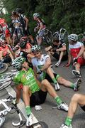 24 May 2010; Riders, including Mark Cassidy, left, and Mark McNally, white jersey, An Post Sean Kelly team, await the decision of UCI Commissaire President Jean-Pierre Coppenolle following an accident involving riders and a car. The Commissaire eventually decided to neutralise the race with approxamatley 50Km to go. FBD Insurance Ras, Stage 2, Dundalk – Carrick-on-Shannon. Picture credit: Stephen McCarthy / SPORTSFILE