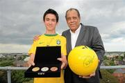 28 May 2010; Carlos Alberto Torres, captain of the 1970 Brazil World Cup winning team, was in Dublin to launch the Pele Goals for Life Cup competition on behalf of his great friend which will benefit the Little Prince Hospital in Curitiba, Brazil, and the New Children's Hospital of Ireland. The idea is to attract 100 teams from across Ireland to enter a National 5 a side competition and in the process raise funding to benefit both hospitals. The competition's winning team will travel on a trip of a lifetime to the cradle of football, Brazil, to be guests of the legendary Pele at a Santos game at the famous Vila Belmiro Stadium. The winners will also visit the Little Prince Hospital and also have the opportunity to play a 5 a side game in Santos and Rio de Janeiro. Pictured at the launch is Carlos Alberto Torres with Conor Fitzpatrick, from Sandymount, Dublin. D4 Berkeley Hotel, Ballsbridge, Dublin. Picture credit: Brian Lawless / SPORTSFILE