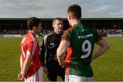 30 April 2016; Referee Padraig Hughes speaks with team captains Stephen Cronin, Cork, left, and Stephen Coen, Mayo. EirGrid GAA Football Under 21 All-Ireland Championship Final, Cork v Mayo. Cusack Park, Ennis, Co. Clare. Picture credit: Piaras Ó Mídheach / SPORTSFILE