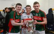 30 April 2016; Mayo players, from left, Eoin O'Donoghue, Scott Kilker and James Kelly celebrate with the cup after the game. EirGrid GAA Football Under 21 All-Ireland Championship Final, Cork v Mayo. Cusack Park, Ennis, Co. Clare. Picture credit: Piaras Ó Mídheach / SPORTSFILE