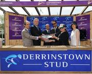 8 May 2016; Joe Osborne, Godolphin Ireland, second left, is presented with the winning trophy by UAE Deputy Ambassador, third right, after winning the Derrinstown Stud Derby Trial Stakes with Moonlight Magic. Horse Racing from Leopardsown - Family Fun Raceday. Leopardstown, Co. Dublin. Picture credit: Seb Daly / SPORTSFILE