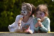 8 May 2016; Seven year old Clíona Culligan and her sister Ashling, aged four, from Whitehall, Co. Dublin, enjoy an icecream at the Family Fun Raceday at Leopardstown. Horse Racing from Leopardsown - Family Fun Raceday. Leopardstown, Co. Dublin. Picture credit: Paul Mohan / SPORTSFILE Picture credit: Paul Mohan / SPORTSFILE