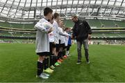 11 May 2016; SPAR FAI Primary School 5s Programme ambassador and former Republic of Ireland International Jason McAteer was at the AVIVA Stadium to watch the SPAR FAI Primary School 5s National Finals where 192 girls and boys from 24 schools battled it out for national honours. The 2016 SPAR FAI Primary School 5s Programme was the biggest yet as almost 24,000 children from 1,267 schools took part in county, regional and provincial blitzes nationwide. For further information please see www.spar.ie or www.faischools.ie Pictured was Jason McAteer shakes hands with pupils from Carns NS, Co. Sligo. Aviva Stadium, Dublin. Picture credit: Matt Browne / SPORTSFILE