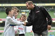 11 May 2016; SPAR FAI Primary School 5s Programme ambassador and former Republic of Ireland International Jason McAteer was at the AVIVA Stadium to watch the SPAR FAI Primary School 5s National Finals where 192 girls and boys from 24 schools battled it out for national honours. The 2016 SPAR FAI Primary School 5s Programme was the biggest yet as almost 24,000 children from 1,267 schools took part in county, regional and provincial blitzes nationwide. For further information please see www.spar.ie or www.faischools.ie Pictured was Jason McAteer who shakes hands with 10 year old Conor Walsh while he was meating pupils from Carns NS, Co. Sligo. Aviva Stadium, Dublin. Picture credit: Matt Browne / SPORTSFILE