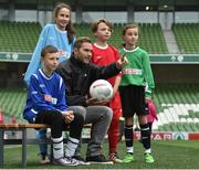 11 May 2016; SPAR FAI Primary School 5s Programme ambassador and former Republic of Ireland International Jason McAteer was at the AVIVA Stadium to watch the SPAR FAI Primary School 5s National Finals where 192 girls and boys from 24 schools battled it out for national honours. The 2016 SPAR FAI Primary School 5s Programme was the biggest yet as almost 24,000 children from 1,267 schools took part in county, regional and provincial blitzes nationwide. For further information please see www.spar.ie or www.faischools.ie Pictured was Jason McAteer with some of the children who took part, from left, Jamie McCoy, from Carns, NS, Gurteen, Co. Sligo, Bea Drummond, from Ardnagrath, NS, Athlone, Co. Westmeath, Cian Fitzgerald, from Croom, NS, Co. Limerick, and Bonnie McKiernan, from Scoil Mhuire, Lacken, Co. Cavan. Aviva Stadium, Dublin. Picture credit: Matt Browne / SPORTSFILE