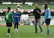 11 May 2016; SPAR FAI Primary School 5s Programme ambassador and former Republic of Ireland International Jason McAteer was at the AVIVA Stadium to watch the SPAR FAI Primary School 5s National Finals where 192 girls and boys from 24 schools battled it out for national honours. The 2016 SPAR FAI Primary School 5s Programme was the biggest yet as almost 24,000 children from 1,267 schools took part in county, regional and provincial blitzes nationwide. For further information please see www.spar.ie or www.faischools.ie Pictured was Jason McAteer with some of the children who took part, from left, Bonnie McKiernan, from Scoil Mhuire, Lacken, Co. Cavan, Jamie McCoy, from Carns, NS, Gurteen, Co. Sligo, and Bea Drummond, from Ardnagrath, NS, Athlone, Co. Westmeath. Aviva Stadium, Dublin. Picture credit: Matt Browne / SPORTSFILE