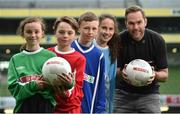 11 May 2016; SPAR FAI Primary School 5s Programme ambassador and former Republic of Ireland International Jason McAteer was at the AVIVA Stadium to watch the SPAR FAI Primary School 5s National Finals where 192 girls and boys from 24 schools battled it out for national honours. The 2016 SPAR FAI Primary School 5s Programme was the biggest yet as almost 24,000 children from 1,267 schools took part in county, regional and provincial blitzes nationwide. For further information please see www.spar.ie or www.faischools.ie. Pictured was Jason McAteer with some of the children who took part, from left, Bonnie McKiernan, from Scoil Mhuire, Lacken, Co. Cavan, Cian Fitzgerald, from Croom, NS, Co. Limerick, Jamie McCoy, from Carn, NS, Gurteen, Co. Sligo, Bea Drummond, from Ardnagrath, NS, Athlone, Co. Westmeath. Aviva Stadium, Dublin. Picture credit: Matt Browne / SPORTSFILE