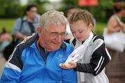 11 June 2010; George Hamilton, from Faythe, Wexford, age 76, who is the oldest competing athlete, and competed in the Pitch & Putt, with Meg Carr, from Letterkenny, Co. Donegal, age 9, who is the youngest competing athlete and won 5 gold medals and 1 silver medal in Gymnastics, at the second day of the 2010 Special Olympics Ireland Games. University of Limerick, Limerick. Picture credit: Stephen McCarthy / SPORTSFILE