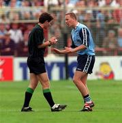 7th, June 1998; Referee Brian White in conversation with Dublin's Keith Barr. Bank of Ireland Leinster Football Championship, Dublin v Kildare, Croke Park. Picture credit: David Maher / SPORTSFILE