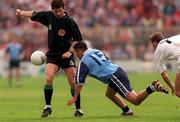 7th, June 1998. Referee Brian White watches over the action with Jason Sherlock, Dublin and Kildare's Anthony Rainbow.    Bank of Ireland Leinster Football Championship, Dublin v Kildare, Croke Park.  Picture Credit David Maher/SPORTSFILE.