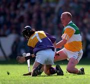 14 June 1998. Offaly's John Troy in action against Wexford's Sean Flood.  Offaly v Wexford, Leinster Hurling Championship, Croke Park. Picture Credit: Ray McManus/SPORTSFILE.