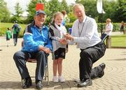 11 June 2010; Micheal O Muircheartaigh with George Hamilton, from Faythe, Wexford, age 76, who is the oldest competing athlete, and competed in the Pitch & Putt, and Meg Carr, from Letterkenny, Co. Donegal, age 9, who is the youngest competing athlete and won 5 gold medals and 1 silver medal in Gymnastics, during the second day of the 2010 Special Olympics Ireland Games. University of Limerick, Limerick. Picture credit: Stephen McCarthy / SPORTSFILE