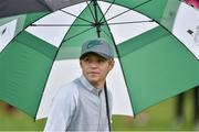 18 May 2016; Singer Niall Horan of One Direction shelters from the rain during the Dubai Duty Free Irish Open Golf Championship Pro-Am at The K Club in Straffan, Co. Kildare. Photo by Brendan Moran/Sportsfile