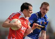 23 May 2010; Shane Lennon, Louth, in action against Noel Farrell, Longford. Leinster GAA Football Senior Championship Preliminary Round, Louth v Longford, O'Moore Park, Portlaoise, Co. Laois. Picture credit: Brian Lawless / SPORTSFILE