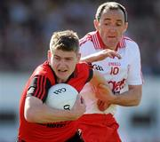 19 June 2010; Conor Maginn, Down, in action against Brian Dooher, Tyrone. Ulster GAA Football Senior Championship Semi-Final, Tyrone v Down, Casement Park, Belfast, Co. Antrim. Picture credit: Oliver McVeigh / SPORTSFILE