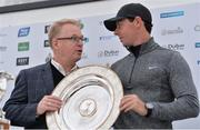 18 May 2016; Keith Pelley, left, Chief Executive of the European Tour, presents Rory McIlroy of Northern Ireland with the Players' Player of the Year trophy during a press conference ahead of the Dubai Duty Free Irish Open Golf Championship Pro-Am at The K Club in Straffan, Co. Kildare. Photo by Brendan Moran/Sportsfile