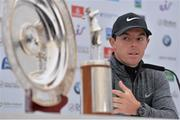 18 May 2016; Rory McIlroy of Northern Ireland looks at the Harry Vardon trophy and the Players' Player of the Year trophy during a press conference ahead of the Dubai Duty Free Irish Open Golf Championship Pro-Am at The K Club in Straffan, Co. Kildare. Photo by Brendan Moran/Sportsfile