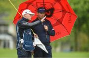 19 May 2016; Padraig Harrington of Ireland in conversation with his caddie Ronan Flood during day one of the Dubai Duty Free Irish Open Golf Championship at The K Club in Straffan, Co. Kildare. Photo by Diarmuid Greene/Sportsfile