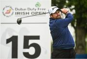 19 May 2016; Shane Lowry of Ireland watches his tee shot from the 15th tee during day one of the Dubai Duty Free Irish Open Golf Championship at The K Club in Straffan, Co. Kildare. Photo by Diarmuid Greene/Sportsfile
