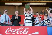 20 June 2010; Turloughmore captain Sean Linnane, alongside Uachtarán Chumann Lúthchleas Gael Criostóir Ó Cuana, second from left, lifts the Christy Ring Trophy after victory over Na Piarsaigh, Cork. Division 1 Hurling Final, Turloughmore, Galway, v Na Piarsaigh, Cork. Coca-Cola GAA Féile na nGael Finals 2010. Cusack Park, Ennis, Co. Clare. Picture credit: Diarmuid Greene / SPORTSFILE