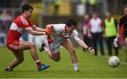 22 May 2016; Branan Molloy of Tyrone in action against Simon McEriain of Derry during the Electric Ireland Ulster GAA Football Minor Championship, Quarter-Final, at Celtic Park, Derry. Photo by Philip Fitzpatrick/Sportsfile