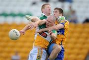 26 June 2010; Offaly goalkeeper Alan Mulhall, left, and full-back Scott Brady contest a high ball with Gary Brennan, Clare. GAA Football All-Ireland Senior Championship Qualifier Round 1, Offaly v Clare, O'Connor Park, Tullamore, Co. Offaly. Picture credit: Brendan Moran / SPORTSFILE
