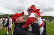 22 May 2016; Tyrone manager Mickey Harte celebrates with his two year old grandson Michael Harte after the Ulster GAA Football Senior Championship, Quarter-Final between Derry and Tyrone at Celtic Park, Derry. Photo by Paul Mohan/Sportsfile