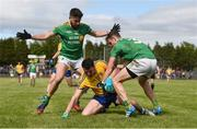 22 May 2016; Diarmuid Murtagh of Roscommon is tackled by Kevin Conlan, left, and Michael McWeeney of Leitrim during the Connacht GAA Football Senior Championship Quarter-Final between Roscommon and Leitrim at Páirc Seán Mac Diarmada in Carrick-on-Shannon, Co. Leitrim. Photo by Ramsey Cardy/Sportsfile
