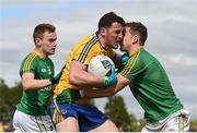 22 May 2016; Diarmuid Murtagh of Roscommon is tackled by Michael McWeeney of Leitrim during the Connacht GAA Football Senior Championship Quarter-Final between Leitrim and Roscommon at Páirc Seán Mac Diarmada in Carrick-on-Shannon, Co. Leitrim. Photo by Ramsey Cardy/Sportsfile
