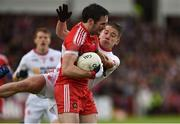 22 May 2016; Oisin Duffy of Derry in action against Mark Bradley of Tyrone during the Ulster GAA Football Senior Championship, Quarter-Final, at Celtic Park, Derry. Photo by Paul Mohan/Sportsfile