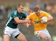3 July 2010; Paddy Cunningham, Antrim, in action against Peter Kelly, Kildare. GAA Football All-Ireland Senior Championship Qualifier Round 1 Replay, Antrim v Kildare, Casement Park, Belfast, Co. Antrim. Picture credit: Paul Mohan / SPORTSFILE