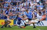 4 June 2016; Con O'Callaghan of Dublin has his shot on goal blocked by Laois goalkeeper Graham Brody and Stephen Attride during the Leinster GAA Football Senior Championship Quarter-Final match between Laois and Dublin in Nowlan Park, Kilkenny. Photo by Stephen McCarthy/Sportsfile