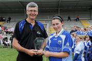 3 July 2010; Dan O'Mahony, President of Munster Ladies Football Association, presents Waterford's Linda Wall with the player of the match trophy. TG4 Ladies Football Munster Intermediate Championship Final, Waterford v Limerick, Castletownroche GAA Grounds, Castletownroche, Co. Cork. Picture credit: Matt Browne / SPORTSFILE