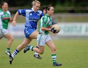 3 July 2010; Dympna O'Brien, Limerick, in action against Mary Foley, Waterford. TG4 Ladies Football Munster Intermediate Championship Final, Waterford v Limerick, Castletownroche GAA Grounds, Castletownroche, Co. Cork. Picture credit: Matt Browne / SPORTSFILE