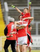 4 July 2010; Moy Davitts, Mayo, player Maks Babianwyk lifts team-mate Michael Guilfoyle after beating Stradbally, Laois, in the Division 2 Boys Final. Coca-Cola GAA Féile Peil na nÓg Finals 2010, Celtic Park, Derry. Picture credit: Paul Mohan / SPORTSFILE