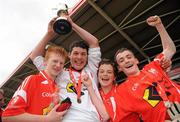 4 July 2010; Moy Davitts, Mayo, players, from left, Conor Byrne, Jonathon McGowan, Paul Langan and Sean Mulroy, celebrate after beating Stradbally, Laois, in the Division 2 Boys Final. Coca-Cola GAA Féile Peil na nÓg Finals 2010, Celtic Park, Derry. Picture credit: Paul Mohan / SPORTSFILE