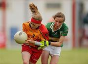 4 July 2010; Dearbhla Byrne, St. Laurences, Kildare, in action against, Megan Glynn, Claregalway, Galway, in the Division 1 Girls Final. Coca-Cola GAA Féile Peil na nÓg Finals 2010, Celtic Park, Derry. Picture credit: Paul Mohan / SPORTSFILE